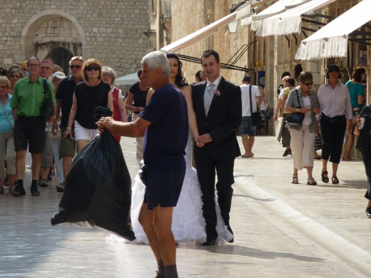 Don't let a guy carrying garbage ruin your wedding photos.