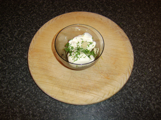 Mixing garlic and chive mayo