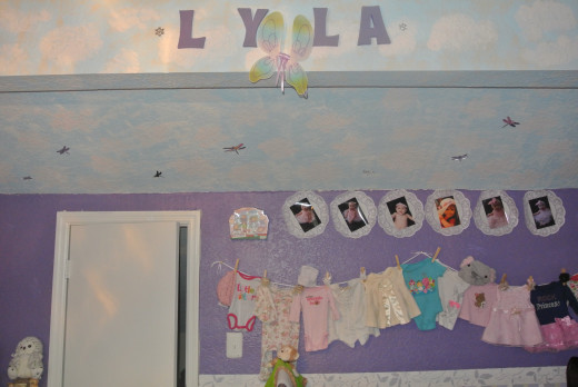 My baby's room had an arched ceiling on one side which offered another way to creatively design and decorate the nursery.  I used that area to create a sky.