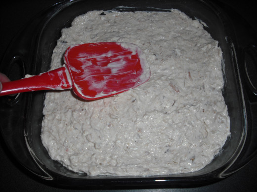 Place into a greased baking dish and smooth out the top.