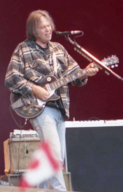 Neil Young performing in Finland 1996.  Young's career has spanned many decades.  He has experimented with different styles over that period, but somehow managed to maintain a distinctive and unique sound.