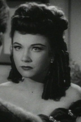 Ann Baxter as Eve, in costume as Margo's understudy.