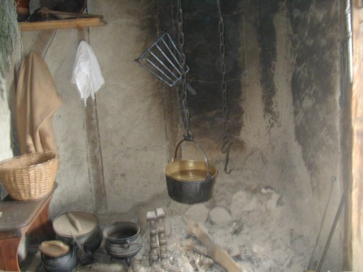 A fireplace cooking area inside an English wigwam, learned from the Wampoanung Nation.