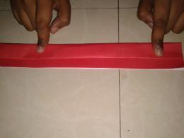 Paper folded till its midline