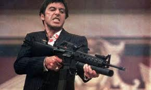 Al Pacino plays as Tony Montana in the film Scarface. It is directed by Brian De Palma and is rated R for intense violence and foul language.