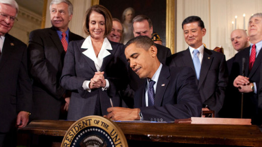 Barack Obama signing the w:Patient Protection and Affordable Care Act at the White House