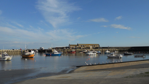 Lyme Regis harbour on a calm and sunny spring day
