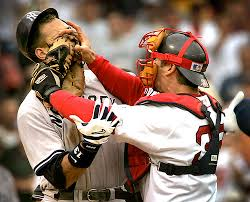 Red Sox team Captain, Jason Varitek, smashes Yankee 3rd baseman, Alex Rodriguez in the face during a heated argument.