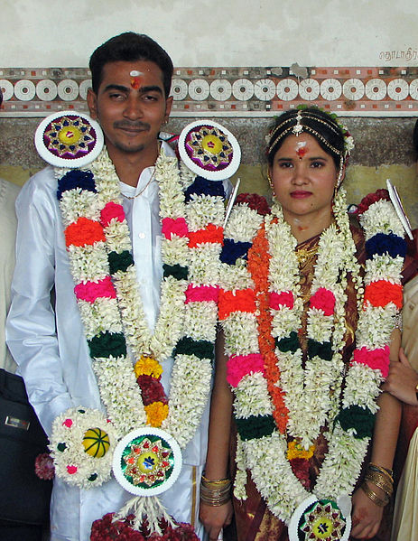 Hindu couple in their wedding dress