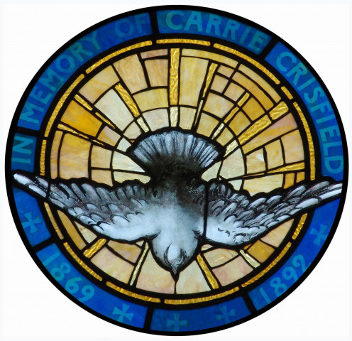 Louis Comfort Tiffany created a stained glass window of the descent of the Holy Spirit promised by Jesus.