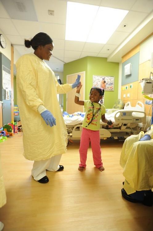 A hospital nurse in action.