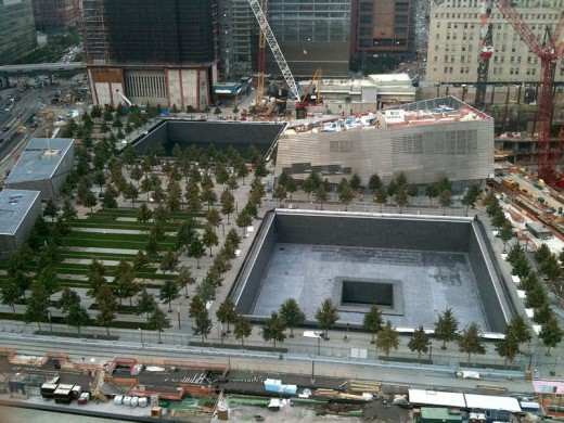 The back of the 9/11 Museum is located behind one Memorial Pool.