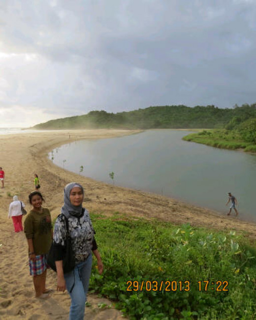 Cipanarikan beach with the estuary nearby.