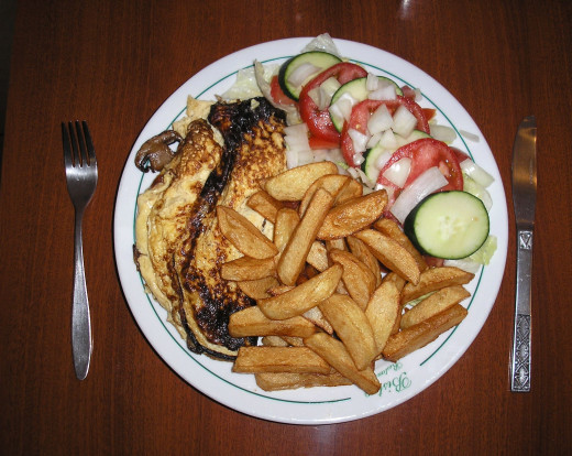 Mushroom omelette, chips and salad