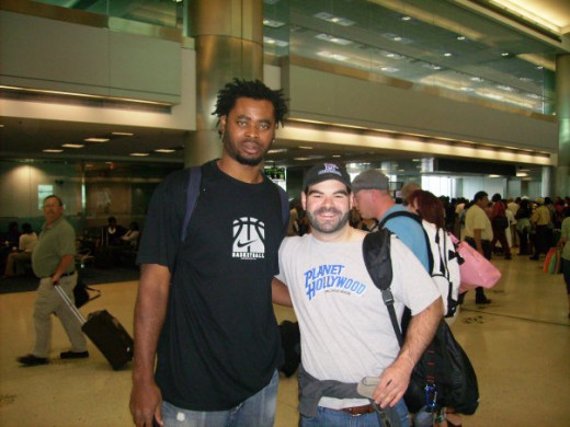I love meeting new people, like this Dominican Republic basketball player on the way to Brazil.  I'm not a small dude, but he was like 7 feet or more. I don't remember.