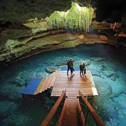 Divers preparing to dive and explore in the blue coolness of Devil's Den.