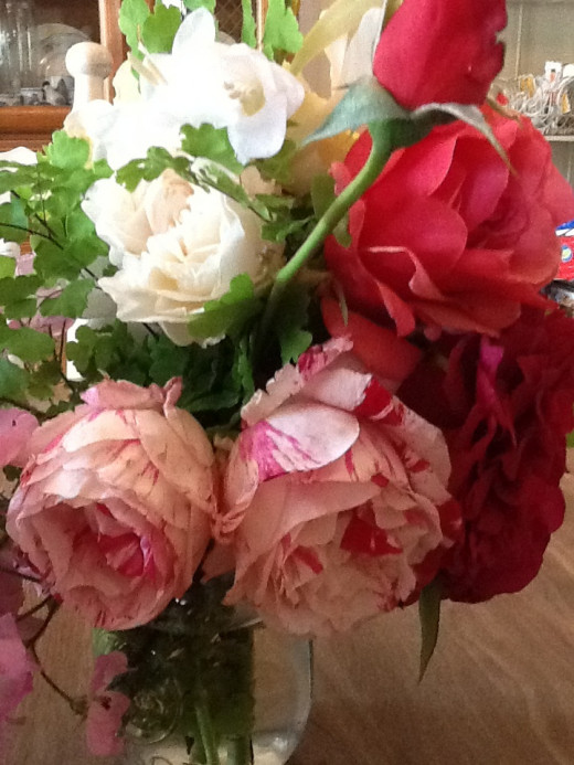 The roses in this bouquet, picked from my rose garden include Duet, The Pilgrim and Scentimental