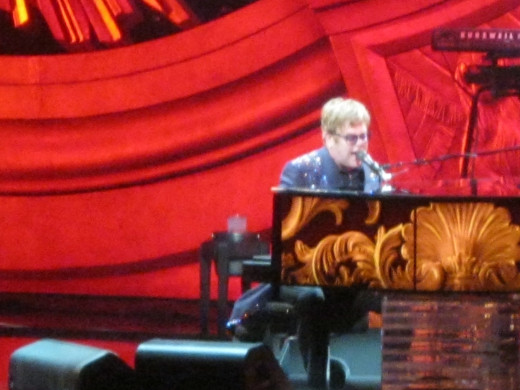 Images are constantly being projected onto the shiny surface of Elton's piano, creating a fascinating show in itself. Elton is definitely an amazing entertainer!