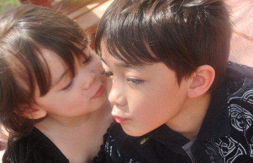 Sweet kisses!  Raising children is rewarding; you can learn so much from them.  The love you share with them is priceless.
