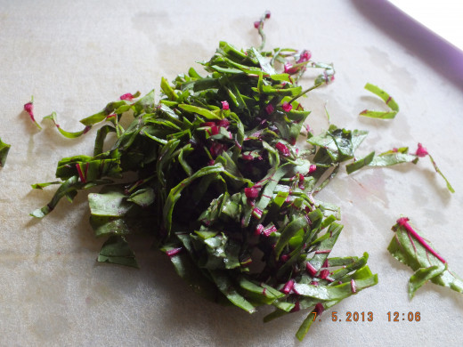 Thinly ribbon the beet tops. I grated the beets raw to serve with the perogies. I love two vegetables in one!