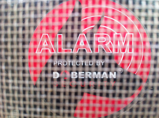 The back of a window alarm showing that the window is protected.