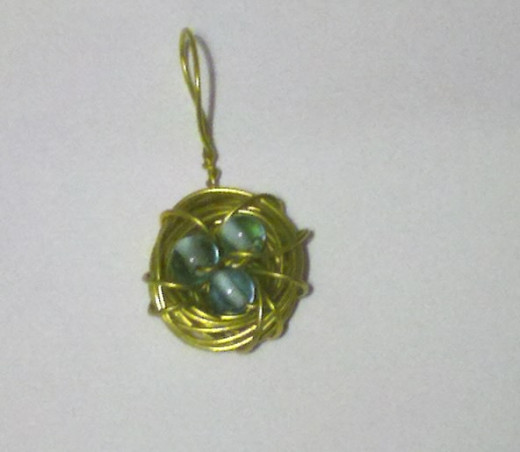 yellow wire with blue beads