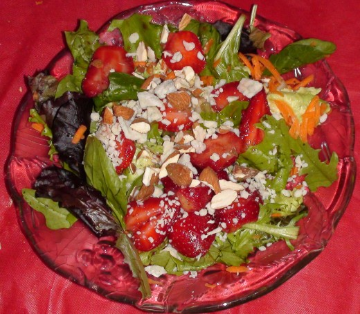Spinach and baby greens with strawberries, almonds, and blue cheese. There are endless variations to this salad!
