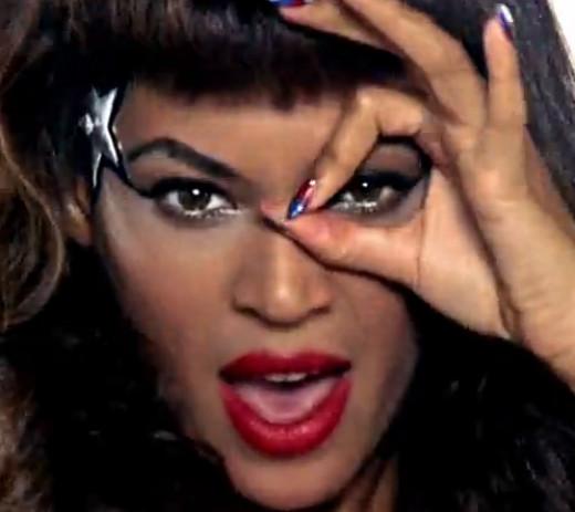 Beyoncé sporting The Eye of Horus and 666 symbol