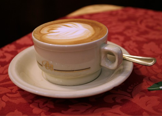 A cappuccino (espresso made with steamed milk, capped off with thick foam) is sometimes the beverage of choice for an Italian breakfast. Italians never order this at any other time of day.