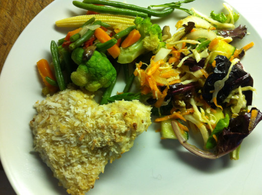 Coconut chicken breasts with stir fry and a salad