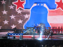 """The Liberty Bell projected into the background during the song """"Philadelphia Freedom."""""""