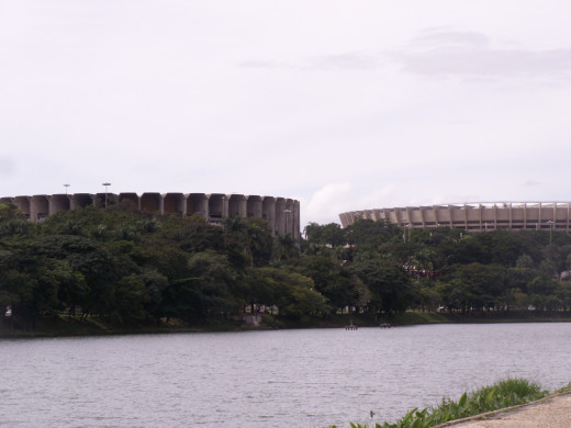 The central lake  where the Saint Francis Church is located with a view of the soccer stadium in Belo Horizonte, Brazil.   This stadium will host world cup games in 2014.  It did so in the 1950s too.