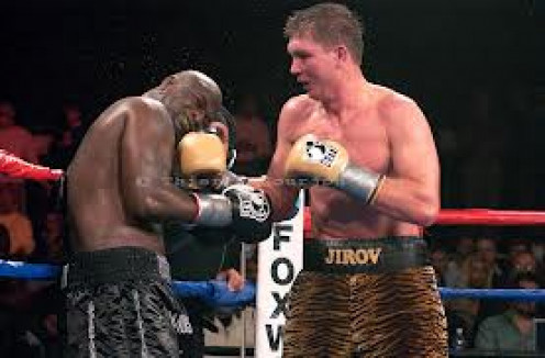 "James "" Lights Out"" Toney seen taking a right hook from Vassily Jirov weathered the storm and  came back. In the 12th round with the fight  hanging in the balance Toney floors Jirov and  wins the title by decision. Jirov is one of the Top cruisers."