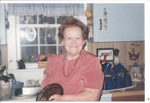 I love this photo of Mom because it's so typical--finding her drying dishes and putting them away.
