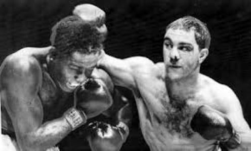 Rocky Marciano, shown pounding out another knockout victory over Ezzard Charles is an all time great boxer. The Rock retired undefeated with a record of 49-0 with 43 knockouts.