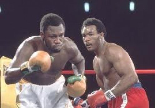 George Foreman won the heavyweight title the first time by knocking out Smokin' Joe Frazier in 2 rounds. George Foreman also won a Gold Medal in the 1968 Olympics.