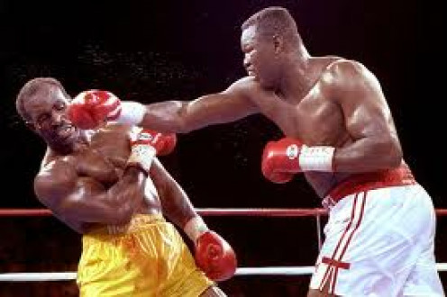 Evander Holyfield defended the heavyweight title by winning a close decision over a 42 year old Larry Holmes.