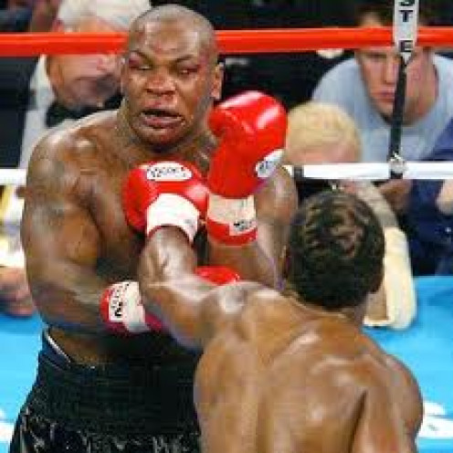Faded ring legend Iron Mike Tyson takes a stiff jab from Hall of Famer Lennox Lewis.