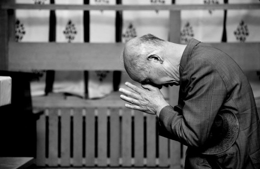 A devotee of Shinto, in silent prayer.