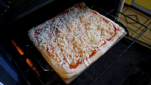 I forgot to take a picture of the pre-cooked dough, this will have to do. I pre-cooked the dough, added sauce and cheese, and put it back into the oven.