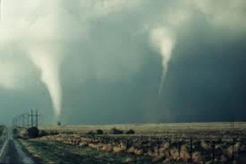 Tornadoes often come in pairs and are accompanied by lightning. Always take cover as soon as possible when you realize a twister is on it's way.