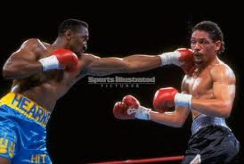 The Hitman Tommy Hearns launches a jab at Quicksilver Virgil Hill.