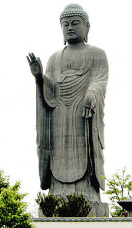 A huge statue of Amitabha, Ushiku Daibitsu, Japan. Amitabha is often depicted in the standing position with one hand lower down while the other in a hand sign. This is known as Mudra.