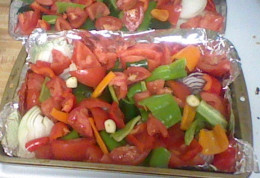 Place all veggies on Cookie SHeets or Baking Pans lined with foil and drizzled with Olive Oil.