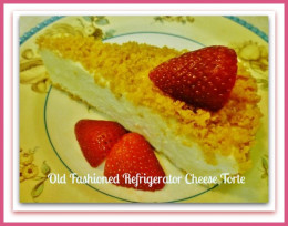 Slice of Refrigerator Cheese Torte adorned with sliced strawberries.