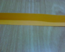 Fold the excess paper into half and snip off the creased line.