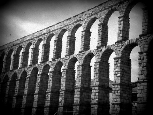 Roman Aqueduct in Segovia, Spain. Without aqueducts, showers would have not been possible back then.