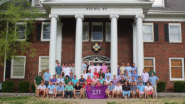 A group of Sigma Pi's in front of their house.