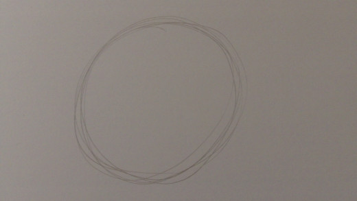 Draw a rough circle which will form the basis of your skull drawing