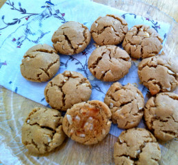 A pretty plate of almond cookies with coconut baked into the bottoms.